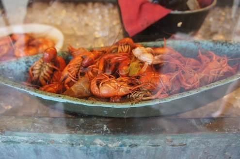 Spiced Crawfish beckon from the street window