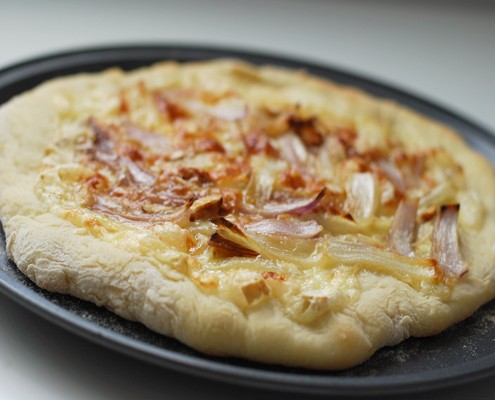 Brie and caramelized onion pizza