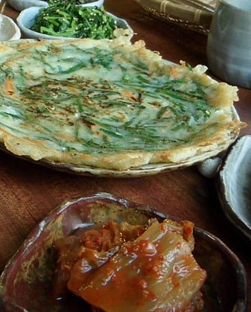 Korean pancake with kimchi on the side