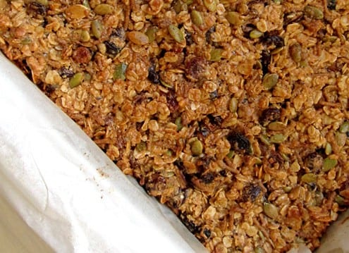 Chewy granola bars baked in the pan.