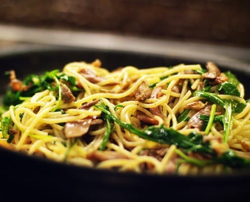 Spaghetti with slow-roasted duck and wilted rocket