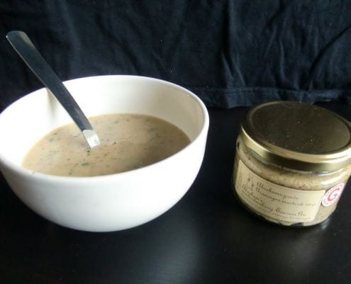 Mustard soup and a jar of Abraham's Groninger mustard.
