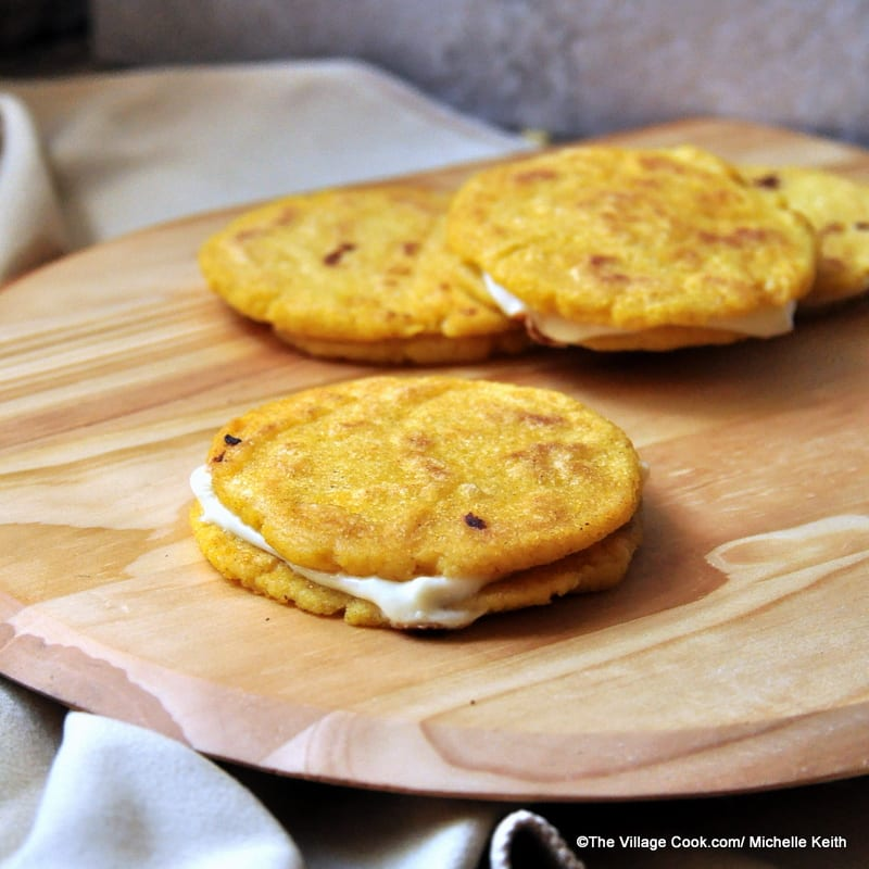 Arepas are made of ground corn dough or cooked flour, and they are ...