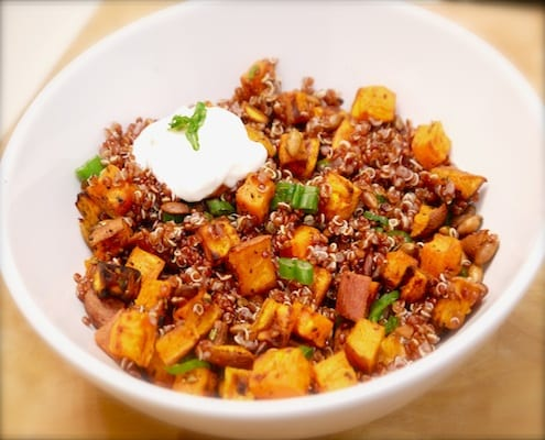 Rosemary, garlic, and paprika roasted sweet potatoes with quinoa, spicy pepitas, and horseradish yogurt sauce