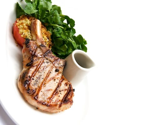 Pork Chop with Watercress and Stuffed Tomatoes