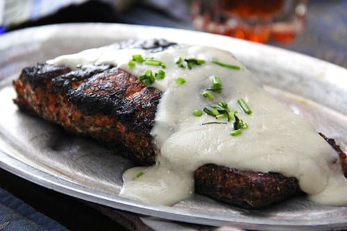 Blackened Salmon topped with Danish Blue Cheese Sauce