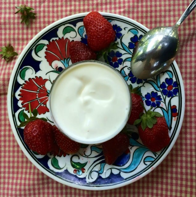 Homemade crème fraîche with strawberries