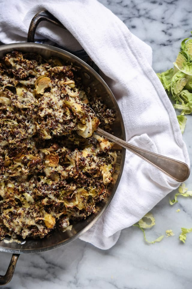 An easy flavorful side dish, this brussels sprout gratin is topped with smoked cheddar cheese and loaded with filling quinoa.