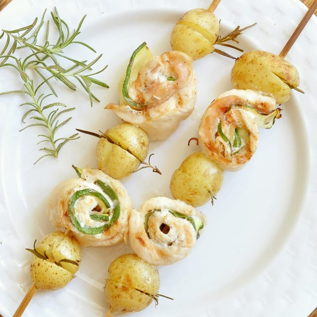 ... chicken, pancetta and zucchini rolls on a skewer, served with rosemary