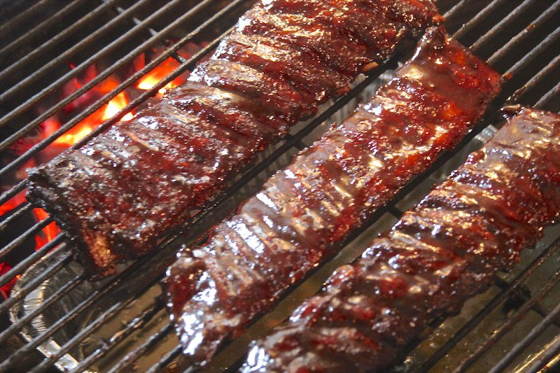 sauced ribs on grill