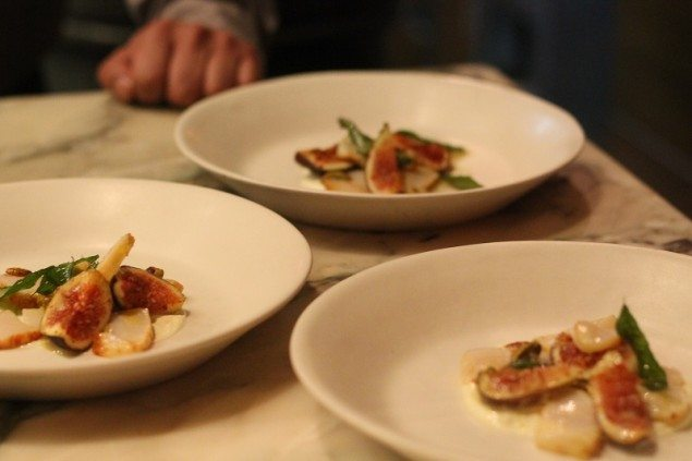 Saffron scallops with mustard seeds, kari leaves, figs and pistachios