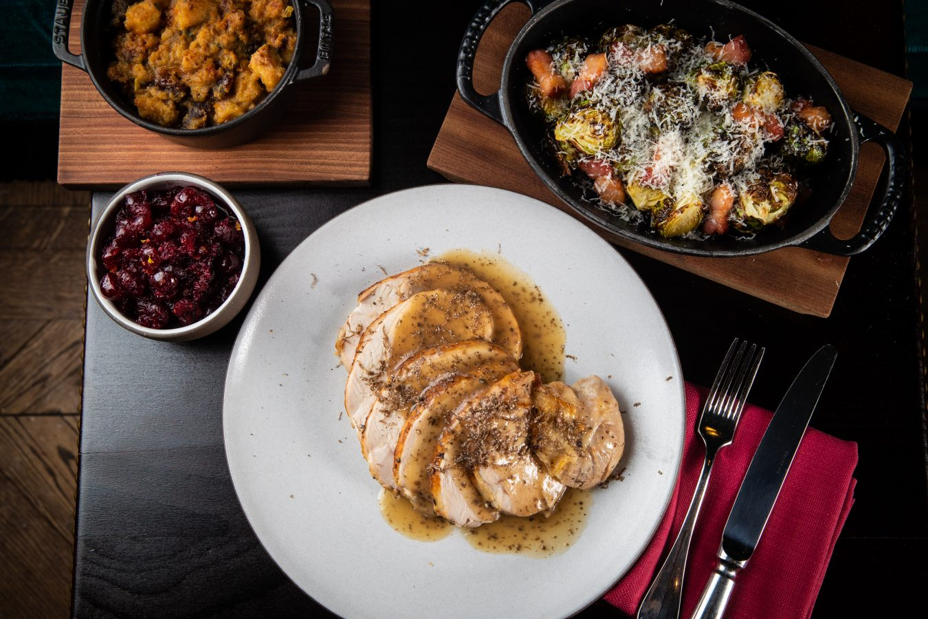NoMad's Roast Turkey paired with creamy parsnip creamy parsnip ecrasse, delicata squash, chestnut stuffing and a rich black truffle gravy